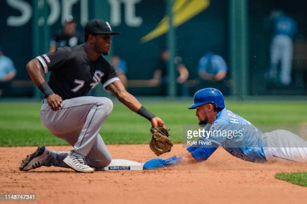 Billy Hamilton of the Kansas City Royals slides safely past the tag from Tim Anderson of the Chicago White Sox in the third inning at Kauffman...