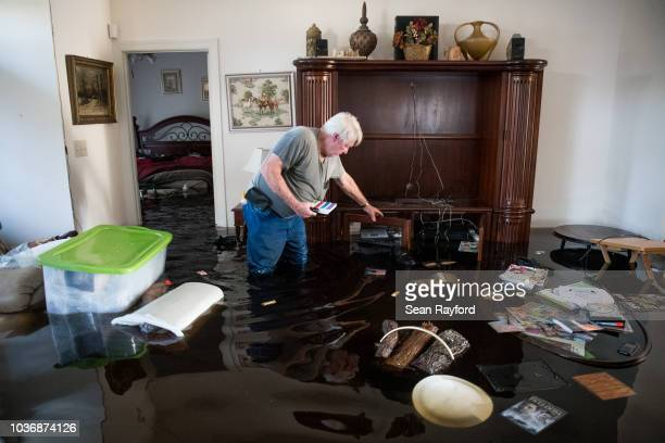 An apartment complex pool is covered by floodwaters at Aberdeen Country Club is inundated by floodwaters caused by Hurricane Florence on September 20...