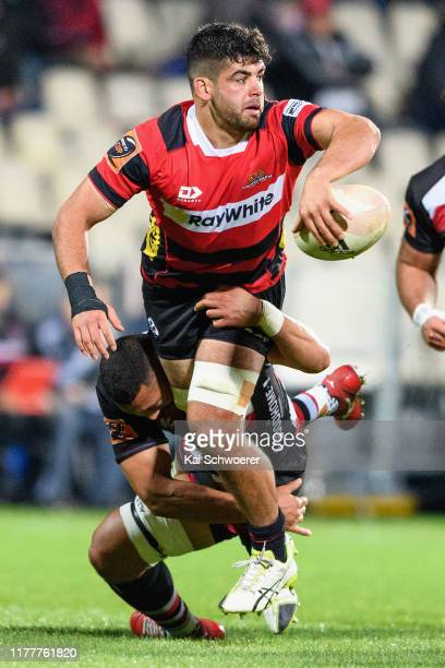 Billy Harmon of Canterbury offloads the ball during the round 8 Mitre 10 Cup match between Canterbury and Counties Manukau at Orangetheory Stadium on...