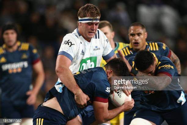 Billy Harmon of the Highlanders is tackled by Sam Darry of the Blues during the round eight Super Rugby Aotearoa match between the Highlanders and...