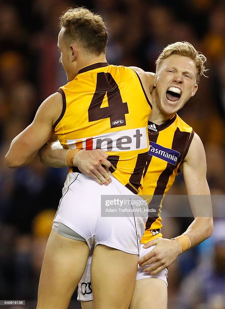 Billy Hartung of the Hawks (left) celebrates a goal with James Sicily of the Hawks during the 2016 AFL Round 13 match between the North Melbourne Kangaroos and the Hawthorn Hawks at Etihad Stadium on June 17, 2016 in Melbourne, Australia.