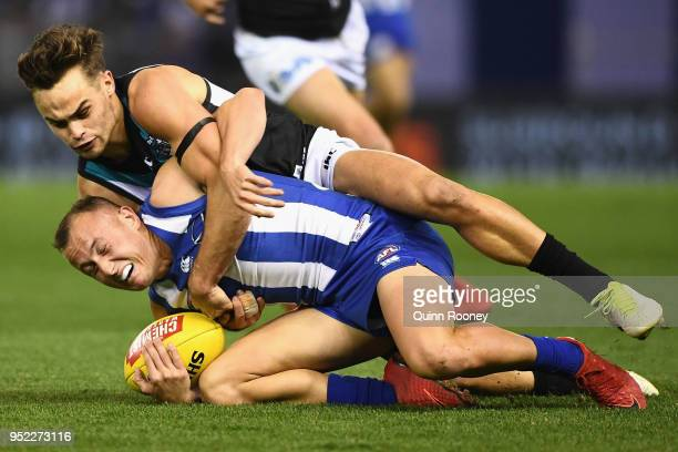 Billy Hartung of the Kangaroos is tackled by Karl Amon of the Power during the round six AFL match between the North Melbourne Kangaroos and Port...