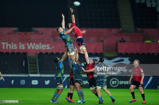 Billy Holland of Munster claims the lineout during the Heineken Champions Cup Round 1 match between the Ospreys and Munster at the Liberty Stadium on...