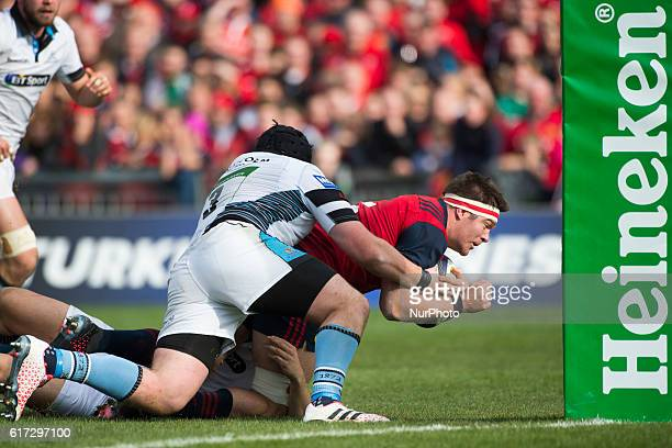 Billy Holland of Munster tackled by Zander Fagerson of Glasgow during the European Rugby Champions Cup Round 2 match between Munster Rugby and...