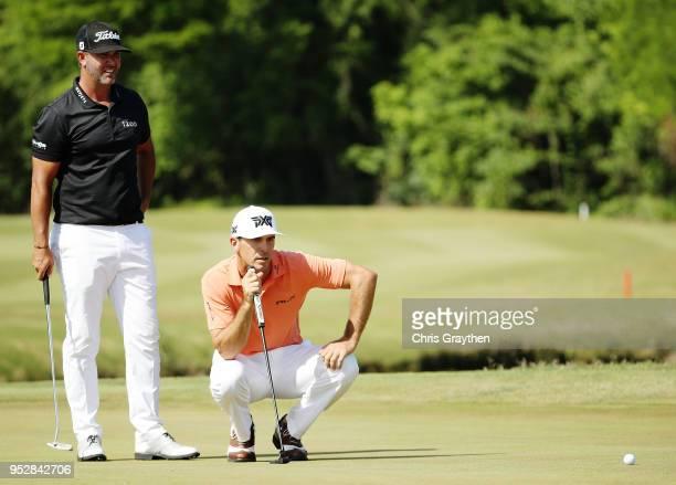 Billy Horschel and Scott Piercy line up a putt on the 16th hole during the final round of the Zurich Classic at TPC Louisiana on April 29 2018 in...