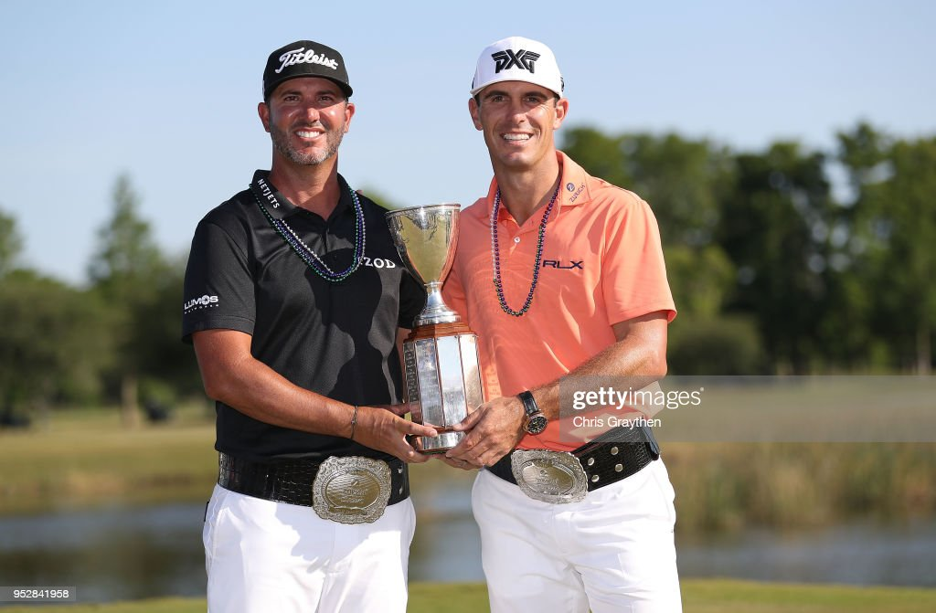 Billy Horschel and Scott Piercy pose with the trophy and commerative belts during the final round of the Zurich Classic at TPC Louisiana on April 29, 2018 in Avondale, Louisiana.