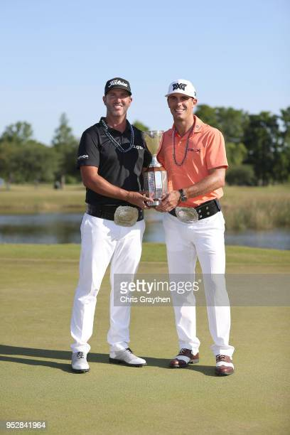 Billy Horschel and Scott Piercy pose with the trophy and commerative belts during the final round of the Zurich Classic at TPC Louisiana on April 29...