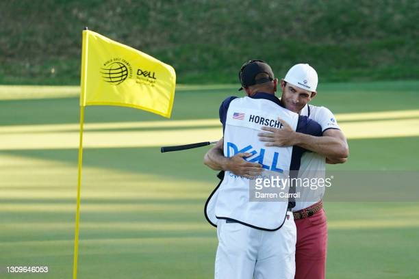 Billy Horschel of the United States celebrates with his caddie after winning 2&1 against Scottie Scheffler of the United States in the final round of...