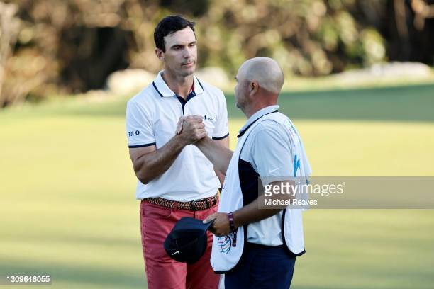Billy Horschel of the United States is congratulated by a caddie after winning 2&1 against Scottie Scheffler of the United States in the final round...