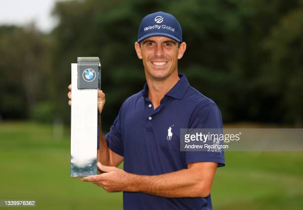 Billy Horschel of the United States of America poses with the trophy after winning The BMW PGA Championship at Wentworth Golf Club on September 12,...