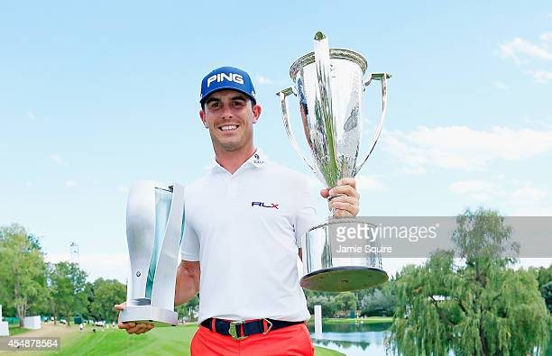 Billy Horschel of the United States poses with the BMW trophy and JK Wadley trophy after his twostroke victory at the of the BMW Championship at the...