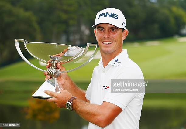 Billy Horschel of the United States poses with the FedExCup on the 18th green after winning both the TOUR Championship by CocaCola and the FedExCup...