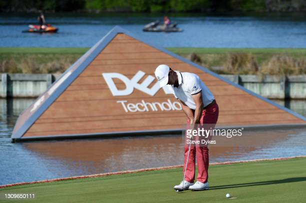Billy Horschel of the United States putts on the 13th green in his match against Scottie Scheffler of the United States during the final round of the...