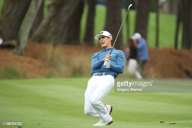 Billy Horschel of the United States reacts after playing a shot on the 15th hole during the third round of The PLAYERS Championship on The Stadium...