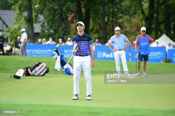 Billy Horschel of the United States reacts to his missed birdie putt on the 18th green during the final round of the Wyndham Championship at...