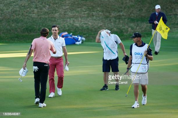 Billy Horschel of the United States shakes hands with Scottie Scheffler of the United States after winning 2&1 in the final round of the World Golf...