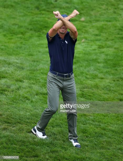 Billy Horschel of The USA makes an X with his arms on his way to the prize presentation on Day Four of The BMW PGA Championship at Wentworth Golf...