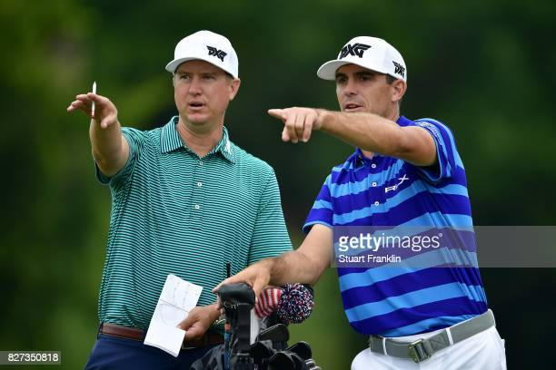 Billy Horschel prepares for a shot with his caddie during a practice round prior to the 2017 PGA Championship at Quail Hollow Club on August 7 2017...