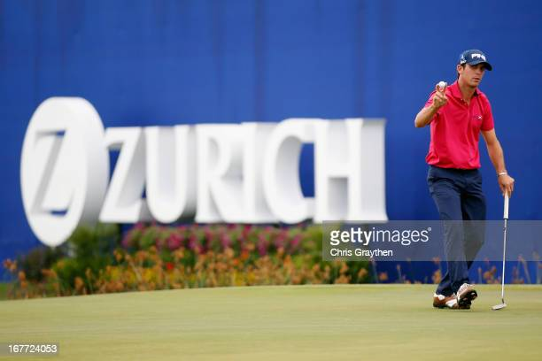 Billy Horschel reacts after making a putt for birdie on the 9th green during the final round of the Zurich Classic of New Orleans at TPC Louisiana on...
