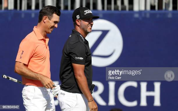 Billy Horschel reacts with teammate Scott Piercy on the 18th hole during the final round of the Zurich Classic at TPC Louisiana on April 29, 2018 in...