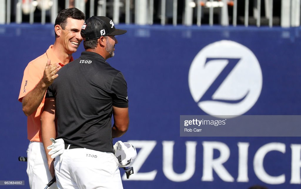 Billy Horschel reacts with teammate Scott Piercy on the 18th hole during the final round of the Zurich Classic at TPC Louisiana on April 29, 2018 in Avondale, Louisiana.