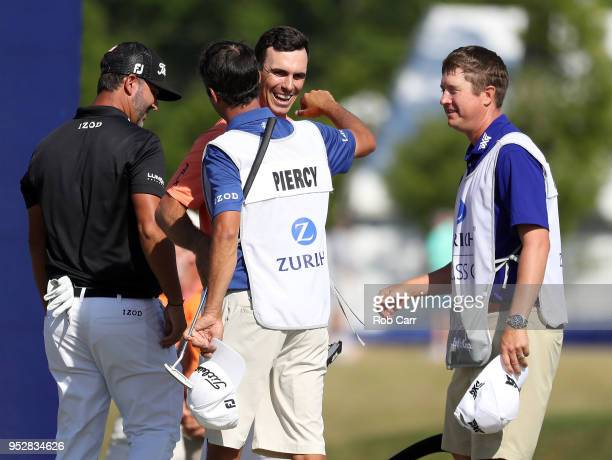 Billy Horschel reacts with teammate Scott Piercy on the 18th hole during the final round of the Zurich Classic at TPC Louisiana on April 29 2018 in...