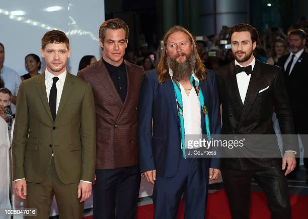 Billy Howle Chris Pine David Mackenzie and Aaron TaylorJohnson attend the premiere of Outlaw King at Roy Thomson Hall on September 6 2018 in Toronto...