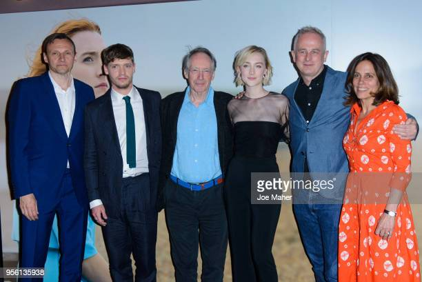 Billy Howle Ian McEwan Saoirse Ronan and Dominic Cooke attend a special screening of 'On Chesil Beach' at The Curzon Mayfair on May 8 2018 in London...