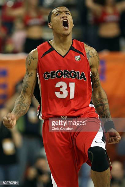 Billy Humphrey of the Georgia Bulldogs celebrates after making a three point shot against the Arkansas Razorbacks during the championship game of the...