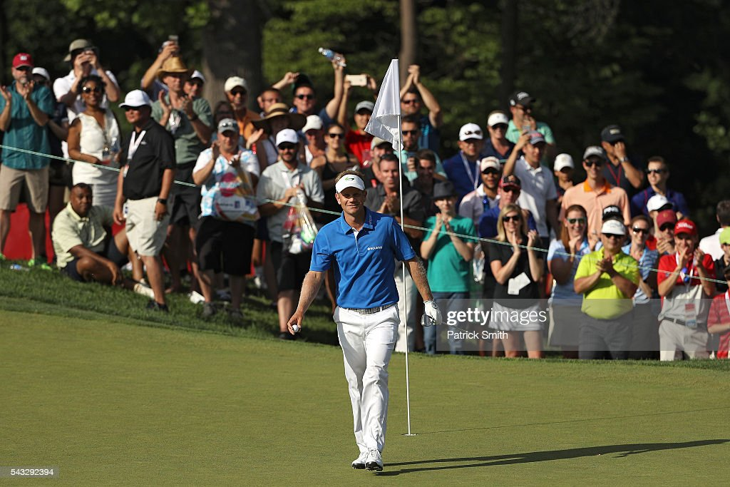 Billy Hurley III celebrates after chipping in for a birdie on the 15th hole during the final round of the Quicken Loans National at Congressional Country Club on June 26, 2016 in Bethesda, Maryland.
