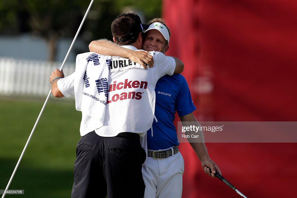 Billy Hurley III celebrates with his caddie after winning the Quicken Loans National at Congressional Country Club on June 26, 2016 in Bethesda, Maryland.