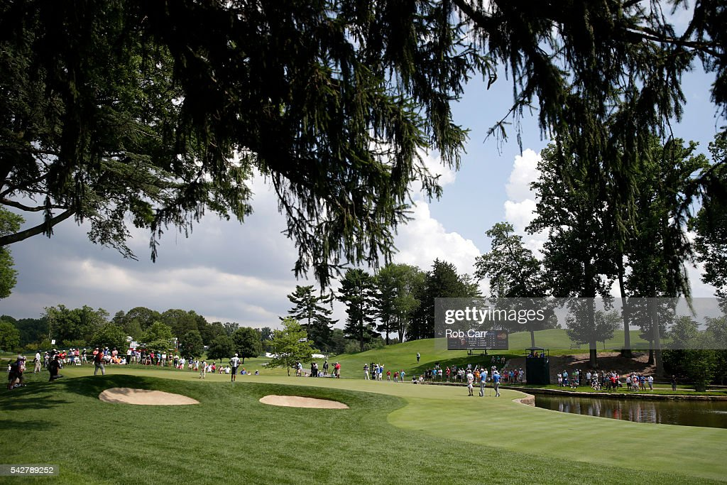 Billy Hurley III putts on the sixth green while Jon Rahm of Spain and Sam Saunders watch during the second round of the Quicken Loans National at Congressional Country Club on June 24, 2016 in Bethesda, Maryland.