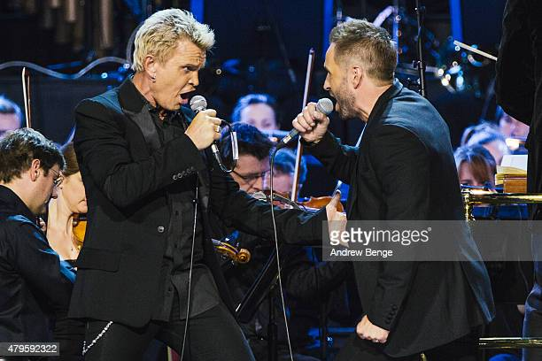 Billy Idol and Alfie Boe perform on stage at Royal Albert Hall on July 5 2015 in London United Kingdom