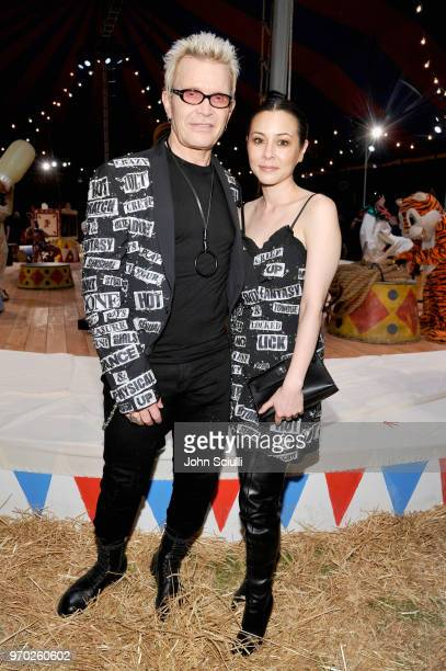 Billy Idol and China Chow attend the Moschino Spring/Summer 19 Menswear and Women's Resort Collection at Los Angeles Equestrian Center on June 8 2018...