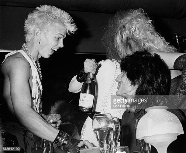 Billy Idol and Ron Wood attend Perri Lister Birthday Party on April 10 1984 at the Cat Club in New York City