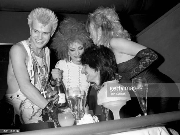 Billy Idol Perri Lister Ron Wood and Jo Wood attend Perri Lister Birthday Party on April 10 1984 at the Cat Club in New York City
