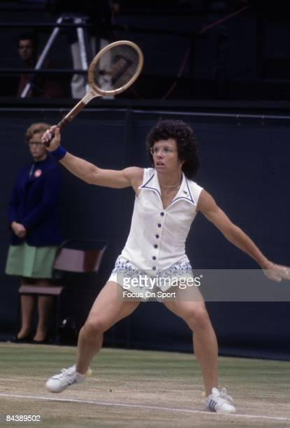 Billy Jean King of the USA hits a backhand return against Evonne Cawley during championship play of the women's singles at the Wimbledon Lawn Tennis...