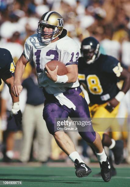 Billy Joe Hobert,Quarterback for the University of Washington Huskies runs the ball during the NCAA Pac-10 Conference college football game against...