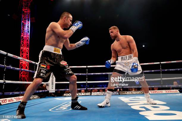 Billy Joe Saunders and Shefat Isufi during the WBO WORLD SUPERMIDDLEWEIGHT CHAMPIONSHIP at The Lamex Stadium on May 18 2019 in Stevenage England