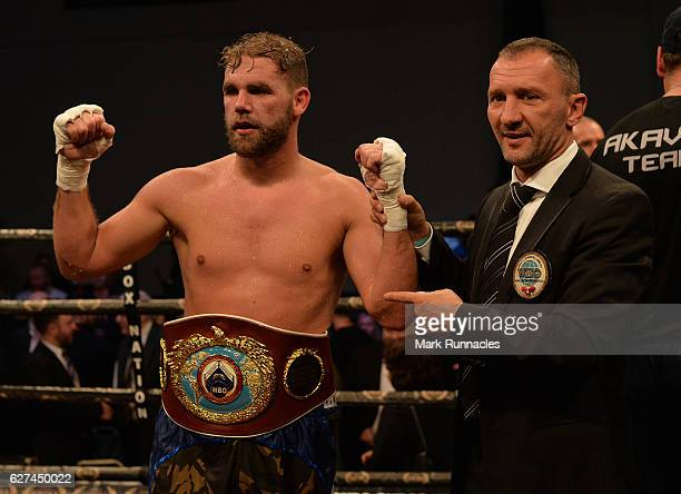 Billy Joe Saunders of England celebrates after beating Artur Akavov of Russia during the first defence of his WBO Middleweight title at the Paisley...