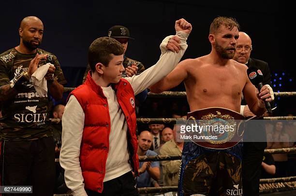 Billy Joe Saunders of England celebrates with cancer patient Lee Wash after beating Artur Akavov of Russia during the first defence of his WBO...
