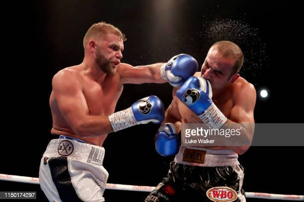 Billy Joe Saunders punches Shefat Isufi during the WBO WORLD SUPERMIDDLEWEIGHT CHAMPIONSHIP at The Lamex Stadium on May 18 2019 in Stevenage England