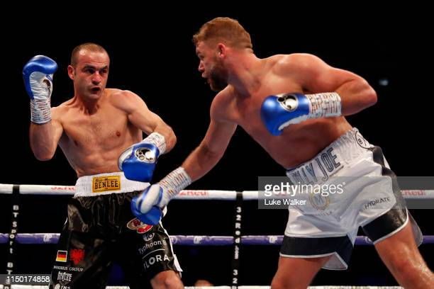 Billy Joe Saunderstries to deliver a punch on Shefat Isufi during the WBO WORLD SUPERMIDDLEWEIGHT CHAMPIONSHIP at The Lamex Stadium on May 18 2019 in...
