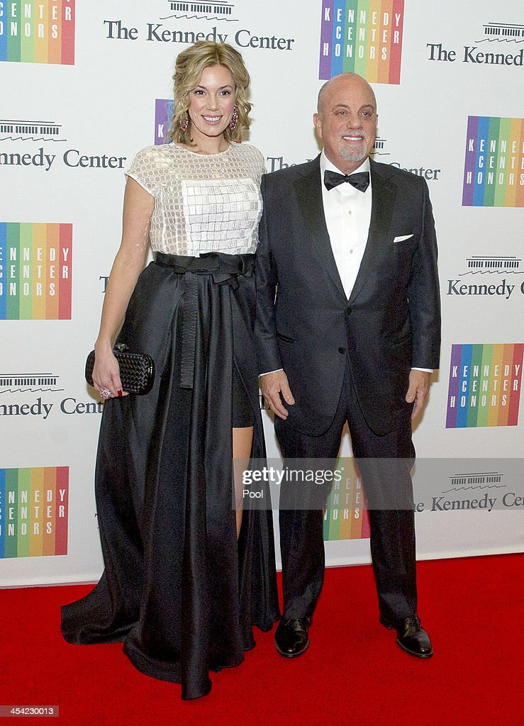 Billy Joel and Alexis Roderick arrive at the formal Artist's Dinner honoring the recipients of the 2013 Kennedy Center Honors hosted by United States Secretary of State John F. Kerry at the U.S. Department of State on December 7, 2013 in Washington, D.C. The 2013 honorees are: opera singer Martina Arroyo, musician/composer Herbie Hancock, singer/songwriter Billy Joel, actress Shirley MacLaine, and musician/songwriter Carlos Santana.