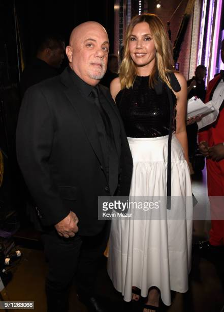 Billy Joel and Alexis Roderick pose backstage during the 72nd Annual Tony Awards at Radio City Music Hall on June 10 2018 in New York City