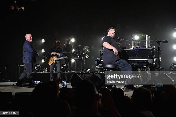 Billy Joel and special guest Kevin James perform onstage during the final show at Nassau Coliseum on August 4 2015 in Long Island New York