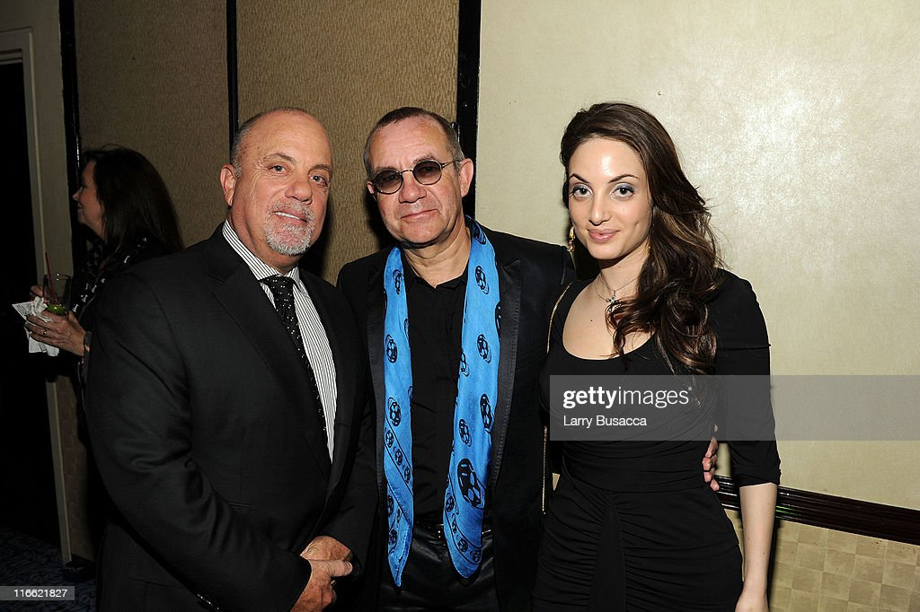 Billy Joel, Bernie Taupin and Alexa Ray Joel attend the Songwriters Hall of Fame 42nd Annual Induction and Awards at The New York Marriott Marquis Hotel - Shubert Alley on June 16, 2011 in New York City.