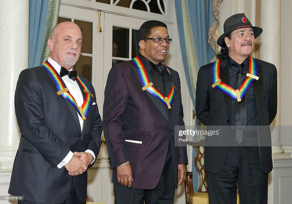 Billy Joel, Herbie Hancock and Carlos Santana attend the formal Artist's Dinner honoring the recipients of the 2013 Kennedy Center Honors hosted by United States Secretary of State John F. Kerry at the U.S. Department of State on December 7, 2013 in Washington, D.C. The 2013 honorees are: opera singer Martina Arroyo, musician/composer Herbie Hancock, singer/songwriter Billy Joel, actress Shirley MacLaine, and musician/songwriter Carlos Santana.