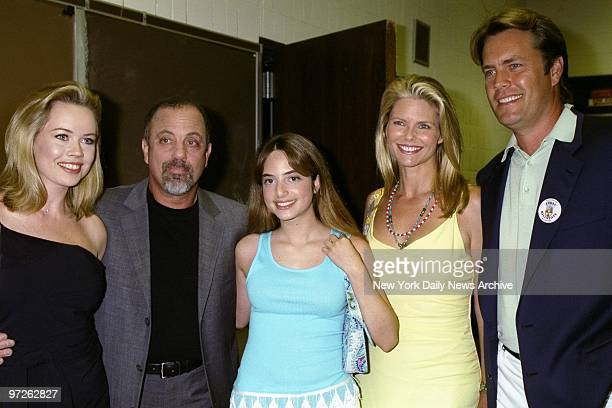 Billy Joel is joined by his girlfriend Trish Bergin his daughter Alexa Christie Brinkley Alexa's mother and Joel's former wife and Brinkley's husband...