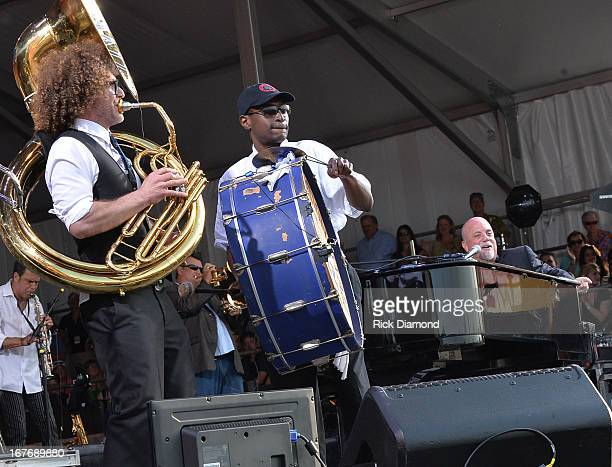 Billy Joel is joined by Preservation Hall Jazz Band of New Orleans and perform during the 2013 New Orleans Jazz Heritage Music Festival at Fair...